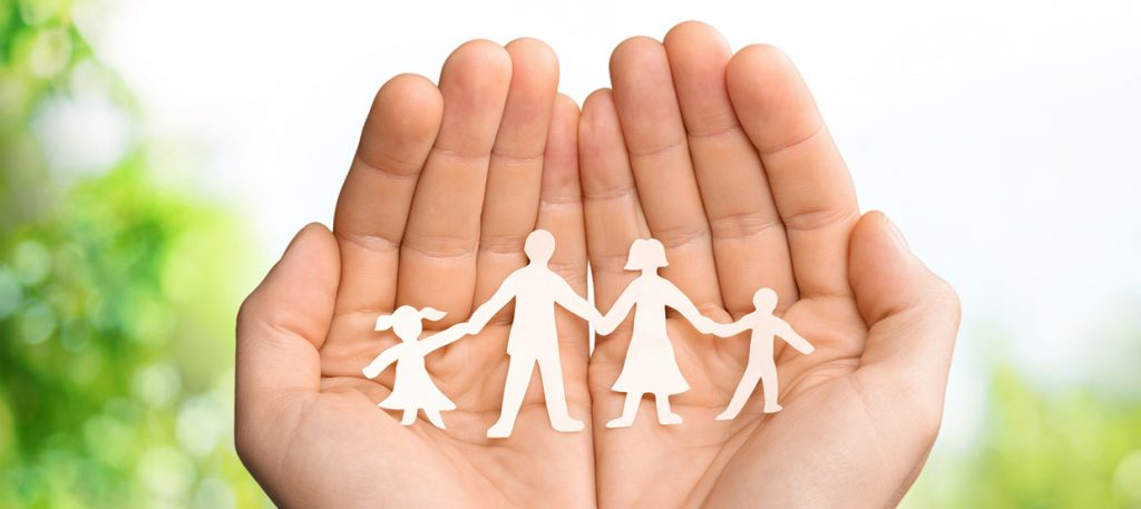 Photo of handing holding paper cut out of family holding hands forLife insurance quote in Florida